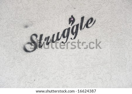 Street Art/Graffiti on textured wall. - stock photo