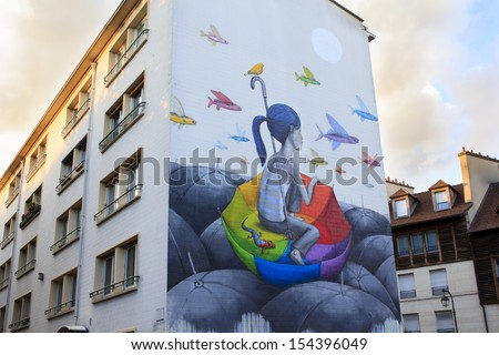 Street art in Paris / ne of Parisian buildings with beautiful painting on it, Paris, France - stock photo