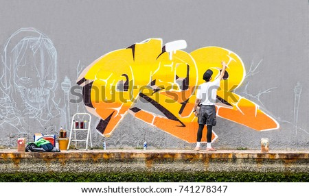 Street Artist Painting Colored Graffiti On Stock Photo (Royalty Free ...