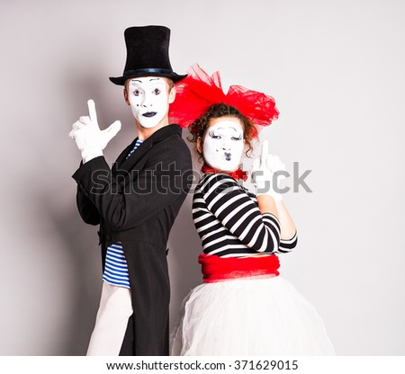 Street artists performing, Two mimes man and  woman in april fools day. - stock photo