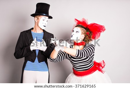 Street artists performing, Two mimes man and  woman in april fools day - stock photo