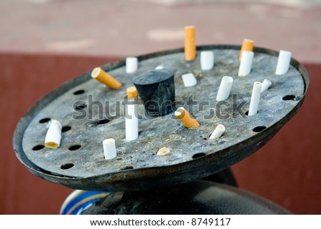 Street ashtray with butts in it - stock photo