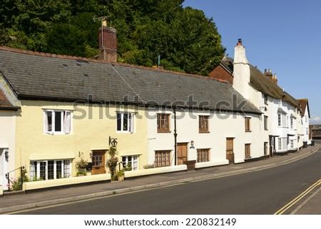 street at Minehead, Somerset view of medieval cottages built with  stone  prospecting on a street just in front of sea in historic touristic village of  Somerset. Shot in bright light  - stock photo