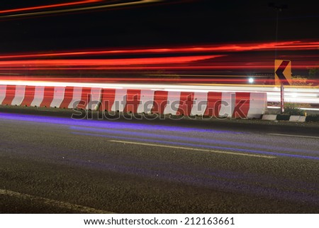 street at night and very fast racing car - stock photo