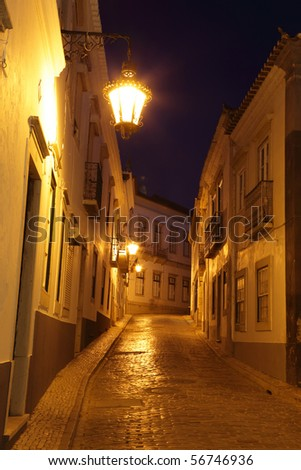 Street at night in the old town of Faro, Portugal - stock photo