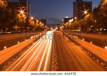 Street at night. Long exposure with cars. - stock photo