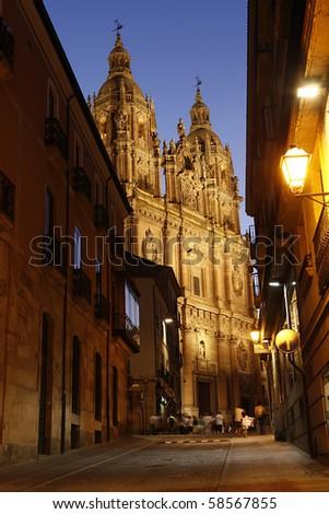 Street at Night with a view at the Clerecia Church, Salamanca, Spain. - stock photo