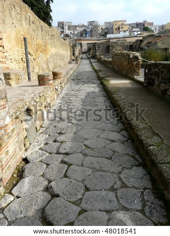 Street at the ancient Roman city of Herculaneum, which was destroyed and buried by ash during the eruption of Mount Vesuvius in 79 AD - stock photo