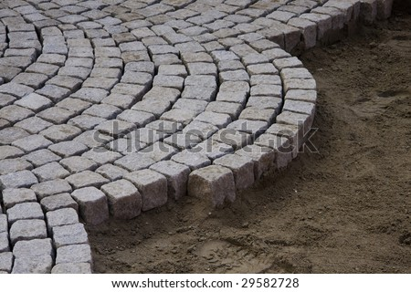 Street being paved with cobblestones - stock photo