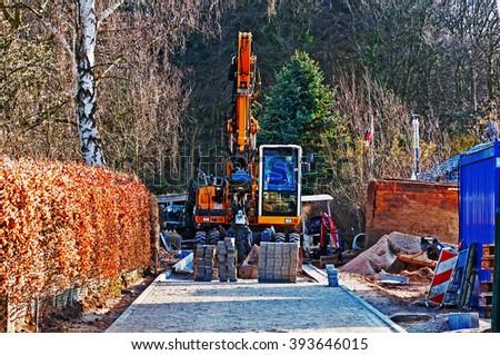 street, building site, excavator - stock photo