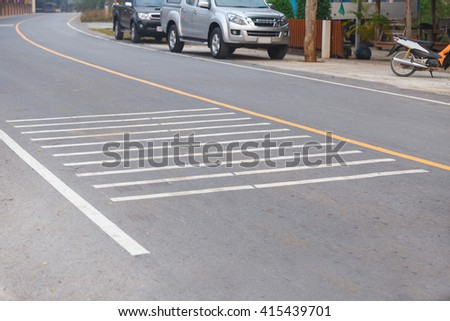 Street bump line for reduce car speed mark on asphalt road. - stock photo