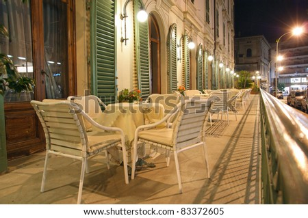 Street cafe at night - stock photo