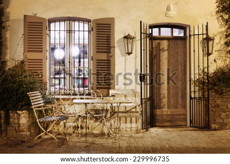Street cafe at night in Saint-Tropez, France - stock photo