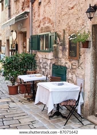 Street cafe in old town Rovinj, istria, Croatia - stock photo