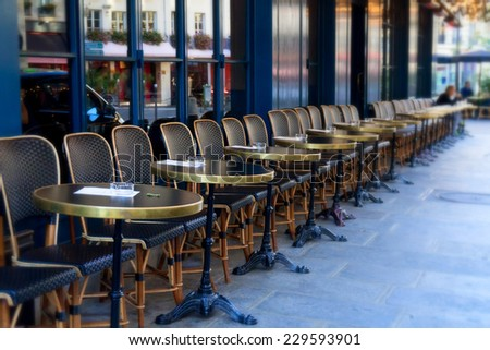 Street cafe terrace with tables and chairs, Paris France - stock photo
