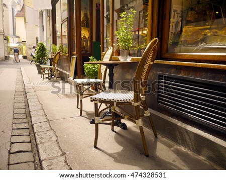 Street cafe vienna style chairs with table in Austria
