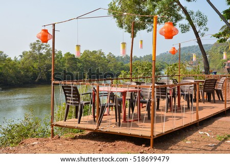 Street cafe with Chinese lanterns on the river Baga in Goa.India