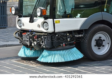 Street cleaner vehicle in the city - stock photo