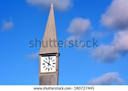 Street clock in the morning against a blue sky with white clouds. concept photo of time. Horizontal - stock photo