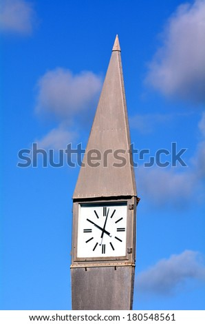 Street clock in the morning against a blue sky with white clouds. concept photo of time. Vertical - stock photo