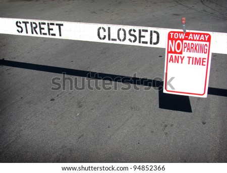 street closed no parking sign and barricade - stock photo