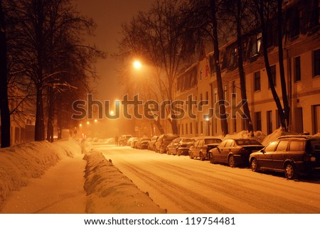 Street covered with snow at night - stock photo