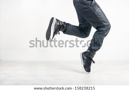 street dance in jeans and sneakers on white background - stock photo