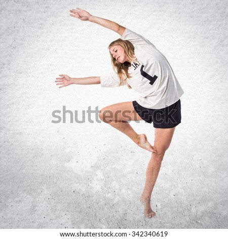 Street dance woman dancing classical dance - stock photo