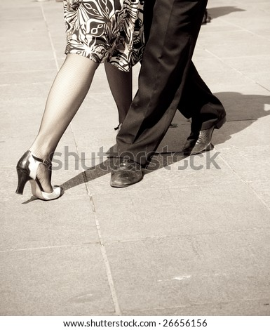 Street dancers performing tango dance. Aged tone. - stock photo