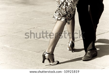 Street dancers performing tango dance. Aged tone. Copy space. - stock photo