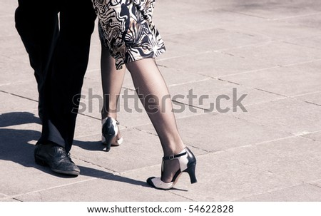 Street dancers performing tango dance. Aged warm tone. - stock photo