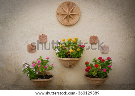 Street decorated with plants and flowers in the historic Italian city of Spello (Umbria, Italy) - stock photo