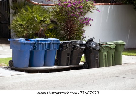 street different colors dustbin containers for different dust - stock photo