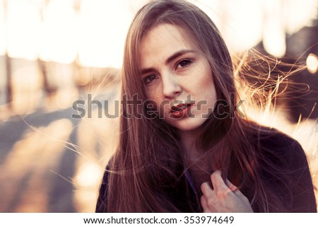 Street fashion sensual closeup of young pretty woman posing outdoor in winter
