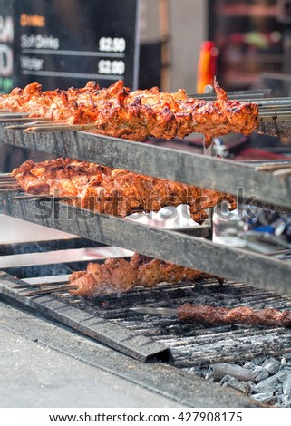 Street Food. Chicken On Skewers Cooking Over Charcoal Grill - stock photo