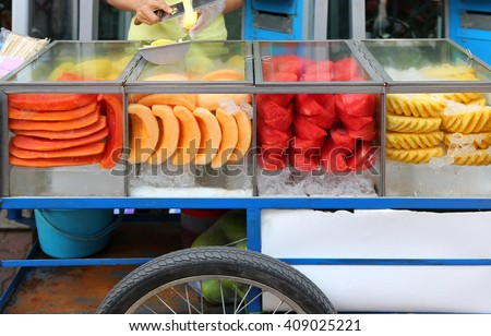 Street food in thailand, Fruit sale in cart - stock photo
