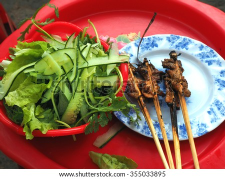 Street food in Vietnam, typical style of dining on street side in Vietnam. - stock photo