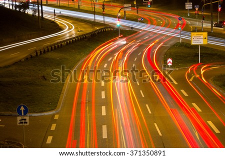 Street in a city at night; - stock photo