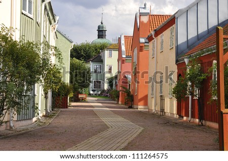 Street in a  picturesque medieval town in Sweden. - stock photo