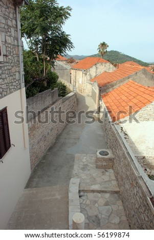 Street in a small Croatian town of Blato on Korcula island in Adriatic sea - stock photo