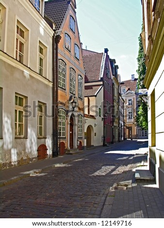 Street in an old European town (Riga, Latvia) - stock photo