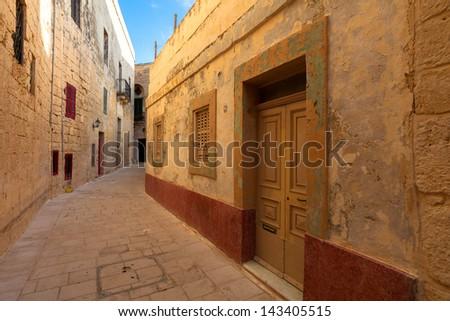 Street in an old mediterranean town Mdina. Malta - stock photo