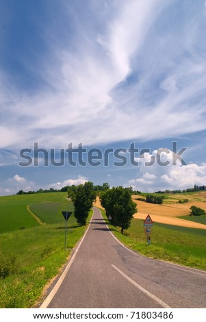 street in countryside under soft clouds