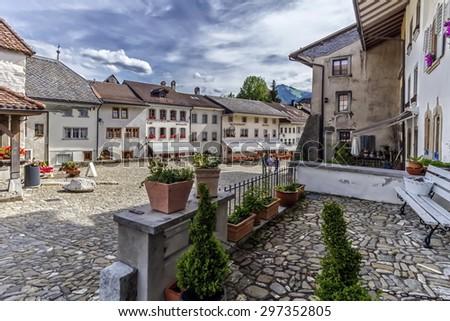 Street in Gruyeres village by day, Fribourg, Switzerland - stock photo