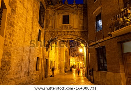 street in historical speak rapidly the cities of Valencia at night, Spain