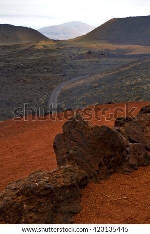 street in los volcanes lanzarote  spain volcanic timanfaya  rock stone sky  hill and summer - stock photo