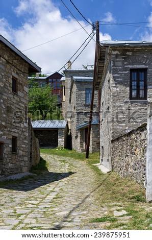 Street in Nimfaio village, Florina, Greece, a popular winter destination - stock photo