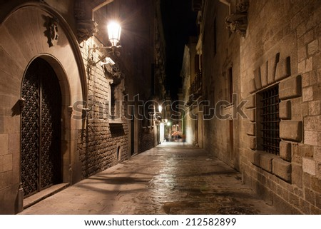 Street in old Gothic Quarter (Barri Gotic) of Barcelona at night in Catalonia, Spain.