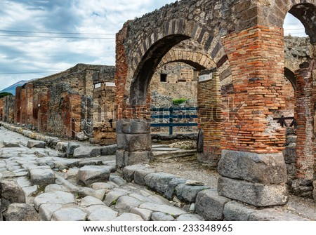 Street in Pompeii, Italy. Pompeii is an ancient Roman city died from the eruption of Mount Vesuvius in 79 AD. - stock photo