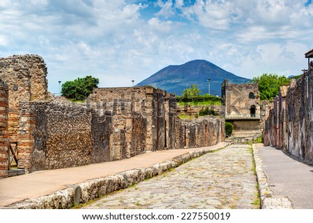 Street in Pompeii overlooking the Vesuvius. Pompeii is an ancient Roman city died from the eruption of Mount Vesuvius in 79 AD. - stock photo